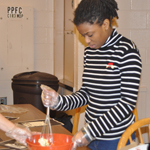 whisking the eggs and butter in the cooking class at the Harbor School for special needs children in New Jersey